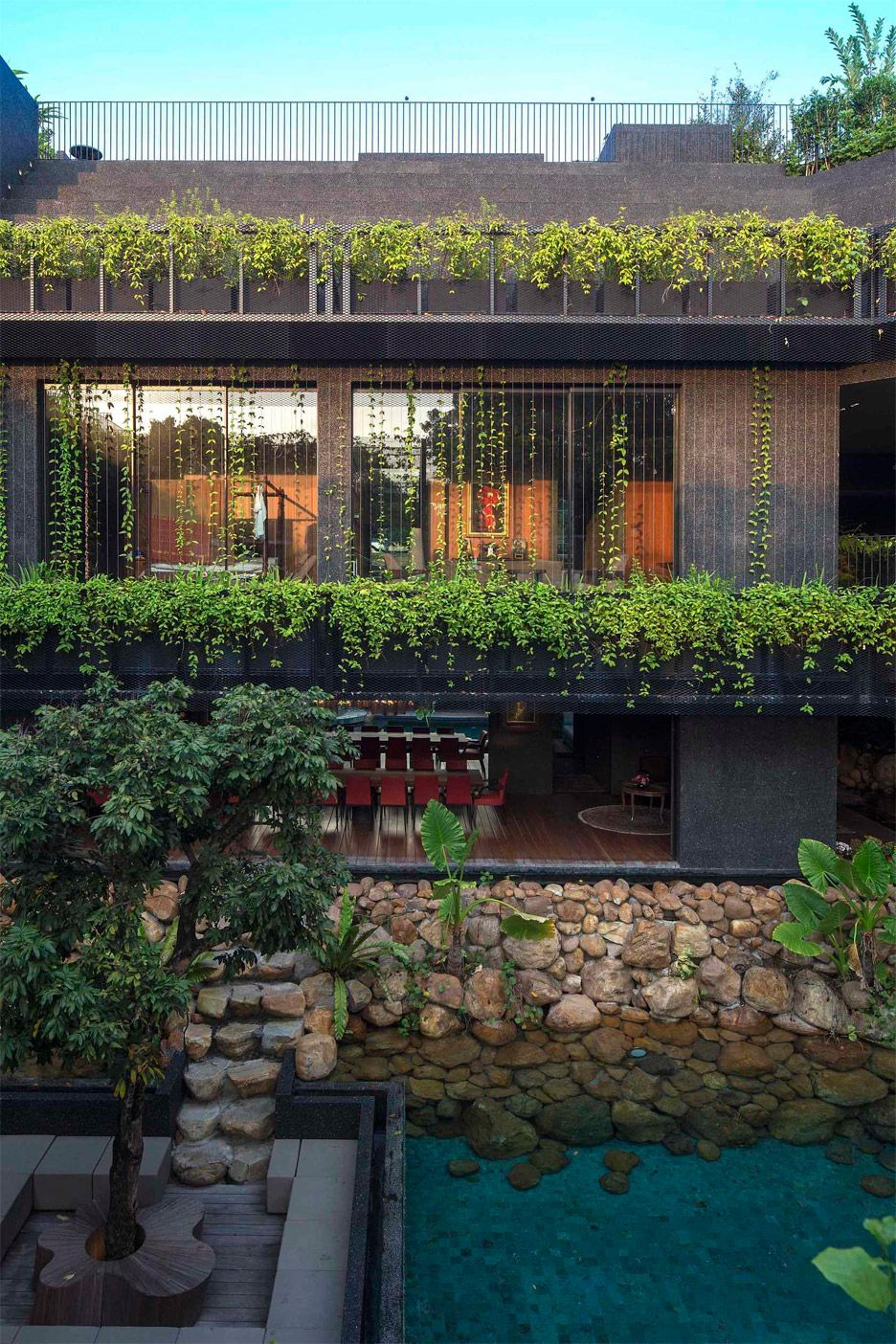 A family home in Singapore draped in greenery, designed by