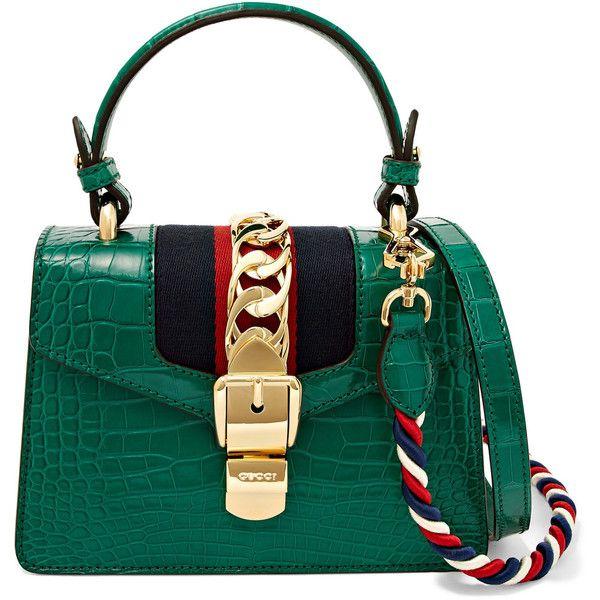 289d09a7afc1 Gucci Sylvie mini chain-embellished alligator shoulder bag (311.410 ARS) ❤  liked on Polyvore featuring bags, handbags, shoulder bags, gucci purse,  gucci ...