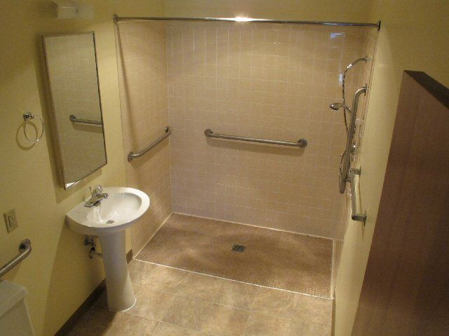 Wheelchair showers one bedroom handicap accessible for Handicapped accessible bathroom plans