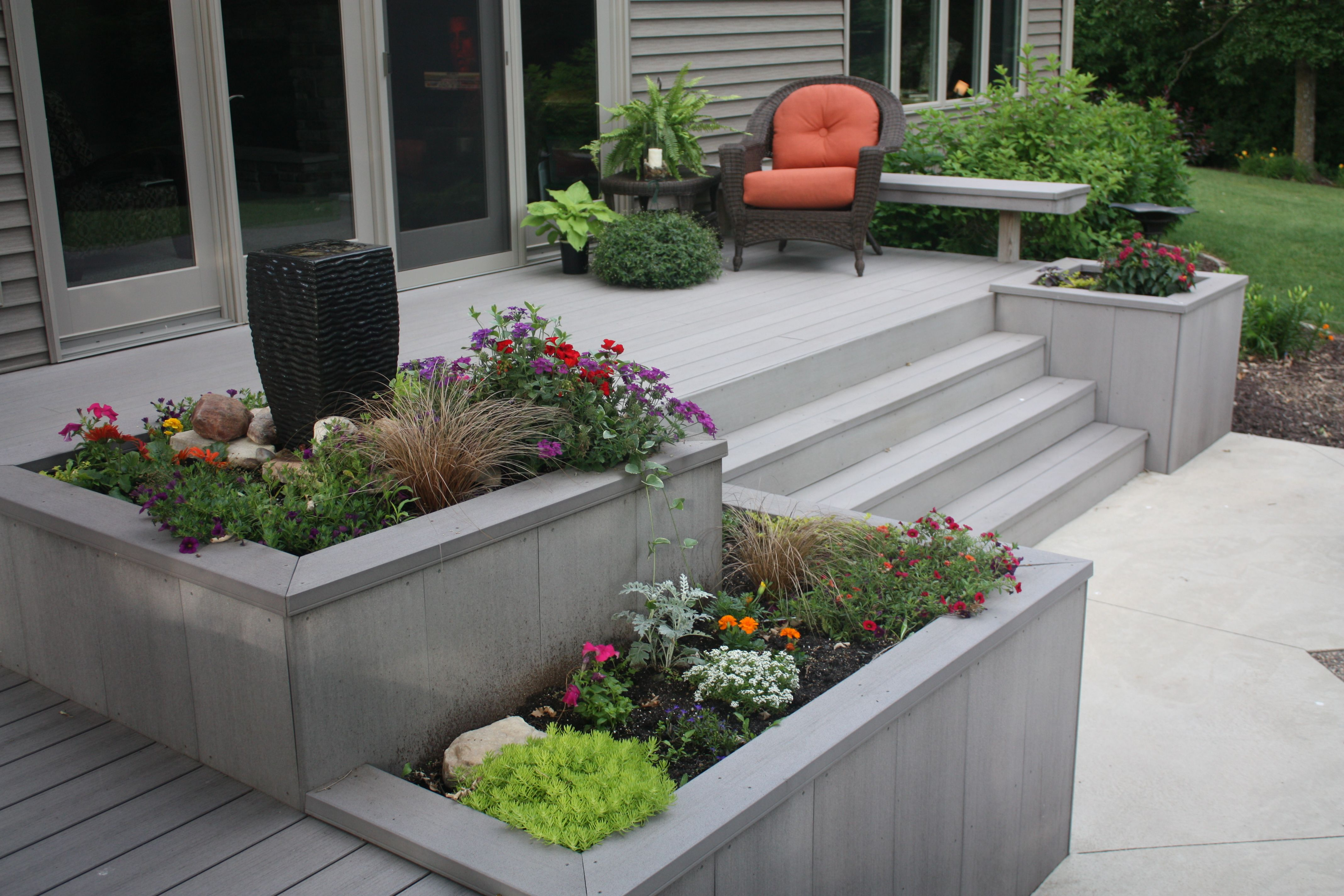 Built in planters with a water fountain.