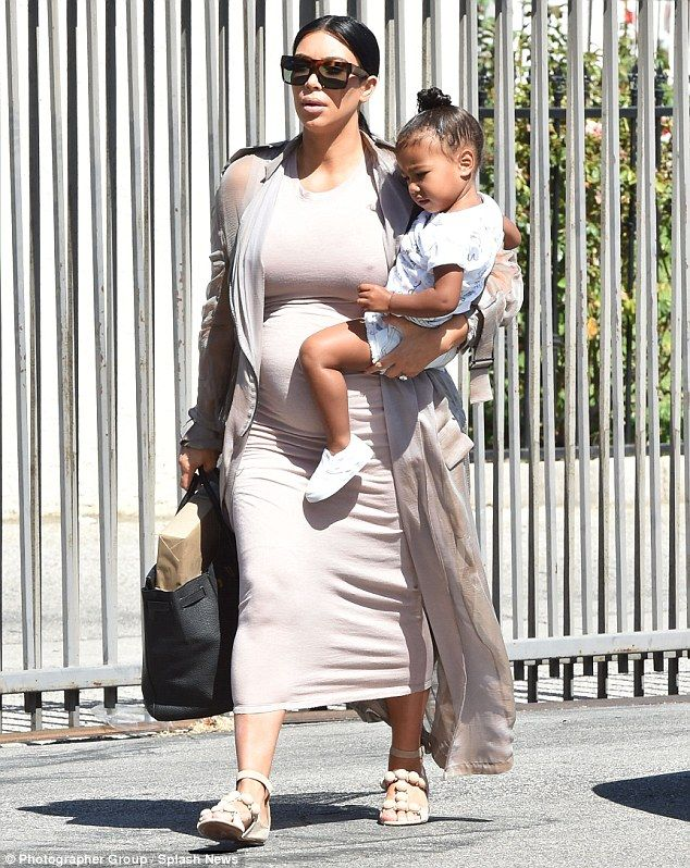 78c020cb642 Looking swell  Kim Kardashian was spotted out in Los Angeles on Sunday  carrying her toddler daughter North West as she took her to dance class