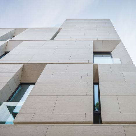 Angled Openings Create Balconies Across The Facade Of Mora