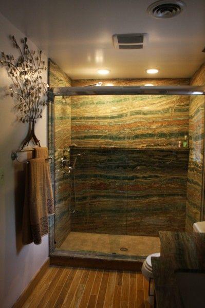 cogswellstone.com // Esmerald Onyx Slab Shower with a Fossil Green ...
