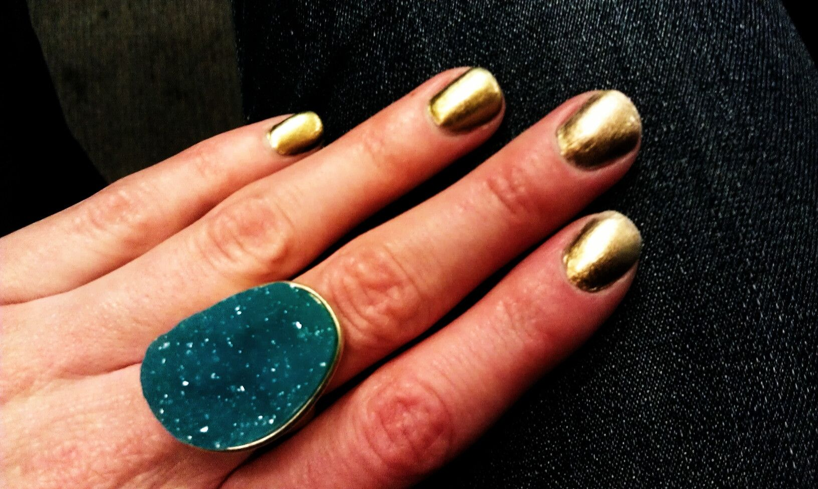 Love the turquoise ring paired with peridot chanel polish.
