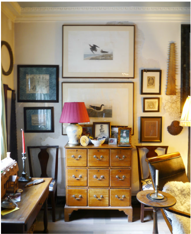 Pair oversized frames over chest - surrounded by smaller art pieces ...