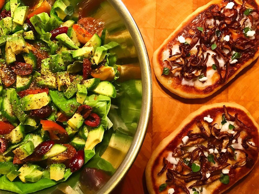 Overeating at lunch means Greek salad and flatbread with shiitake mushrooms, fresh oregano, and vegan feta cheese for dinner. . . .