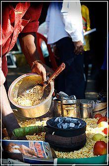A Street Vendor Prepares Bhelpuri In Mumbai