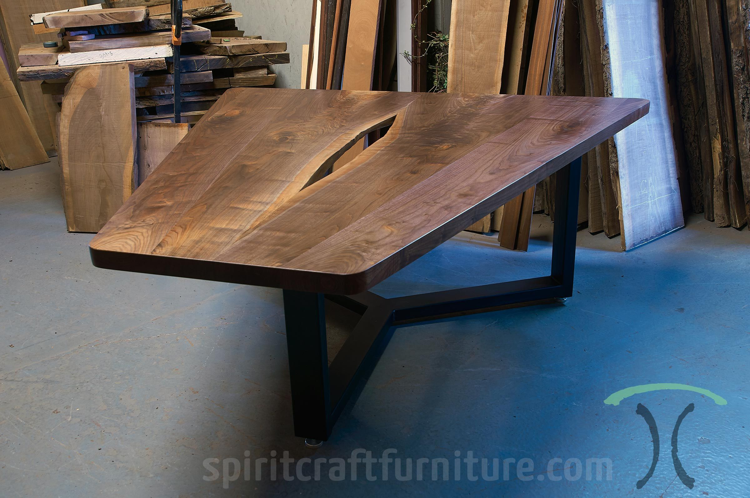 triangular black walnut conference table with live edge center