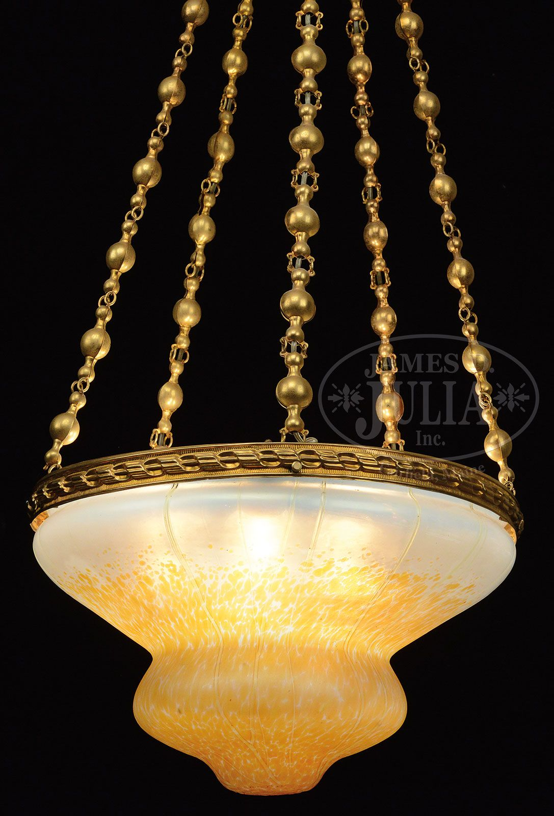 Loetz chandelier loetz chandelier has stamped brass ball chains loetz chandelier loetz chandelier has stamped brass ball chains descending from the spun brass ceiling cap supporting the stamped brass shade ring arubaitofo Gallery