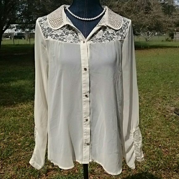 Sheer Lace Button Down Blouse Cute cream colour sheer blouse with longer back. Lace insert on sleeves and around collar. Embellishment on collar. Cute sheer blouse to wear over another top. daytrip  Tops Button Down Shirts