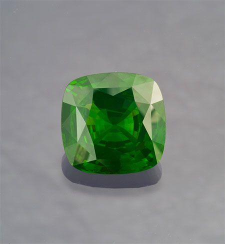 Wide awake. Green zircon, 20.85 carats, cushion cut, 16.15 x 15.80 x 8.79 mm. This stone has been sold. (Photo: Mia Dixon)