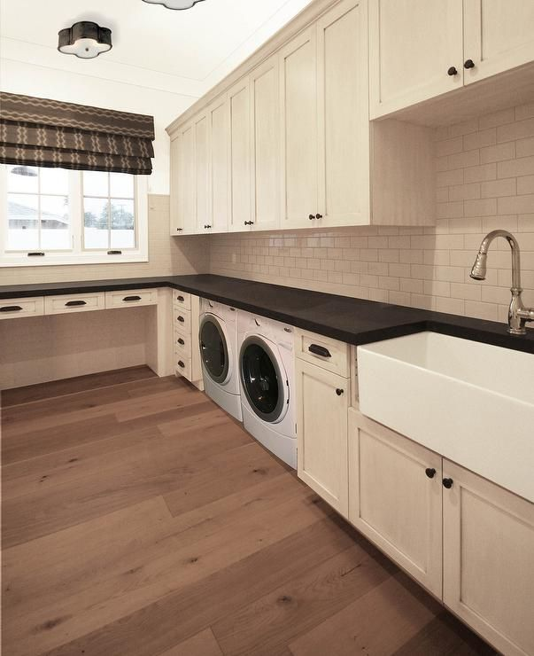 Great Transitional Laundry Room Features Cream Cabinets Adorned With Oil Rubbed  Bronze Cup Pulls Paired With