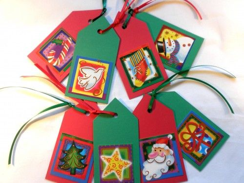 "Gift tags are made from red and green card stock which has been die cut.  Each one has an upclycled holiday image on the front and a ""To"" and ""From"" label on the back.  Each one also has a red or gree"