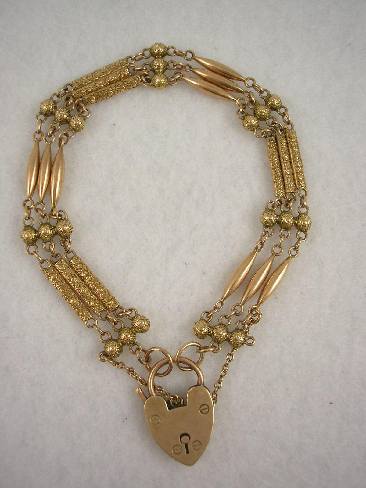Antique Victorian 9K rose gold fancy link padlock bracelet Sold by