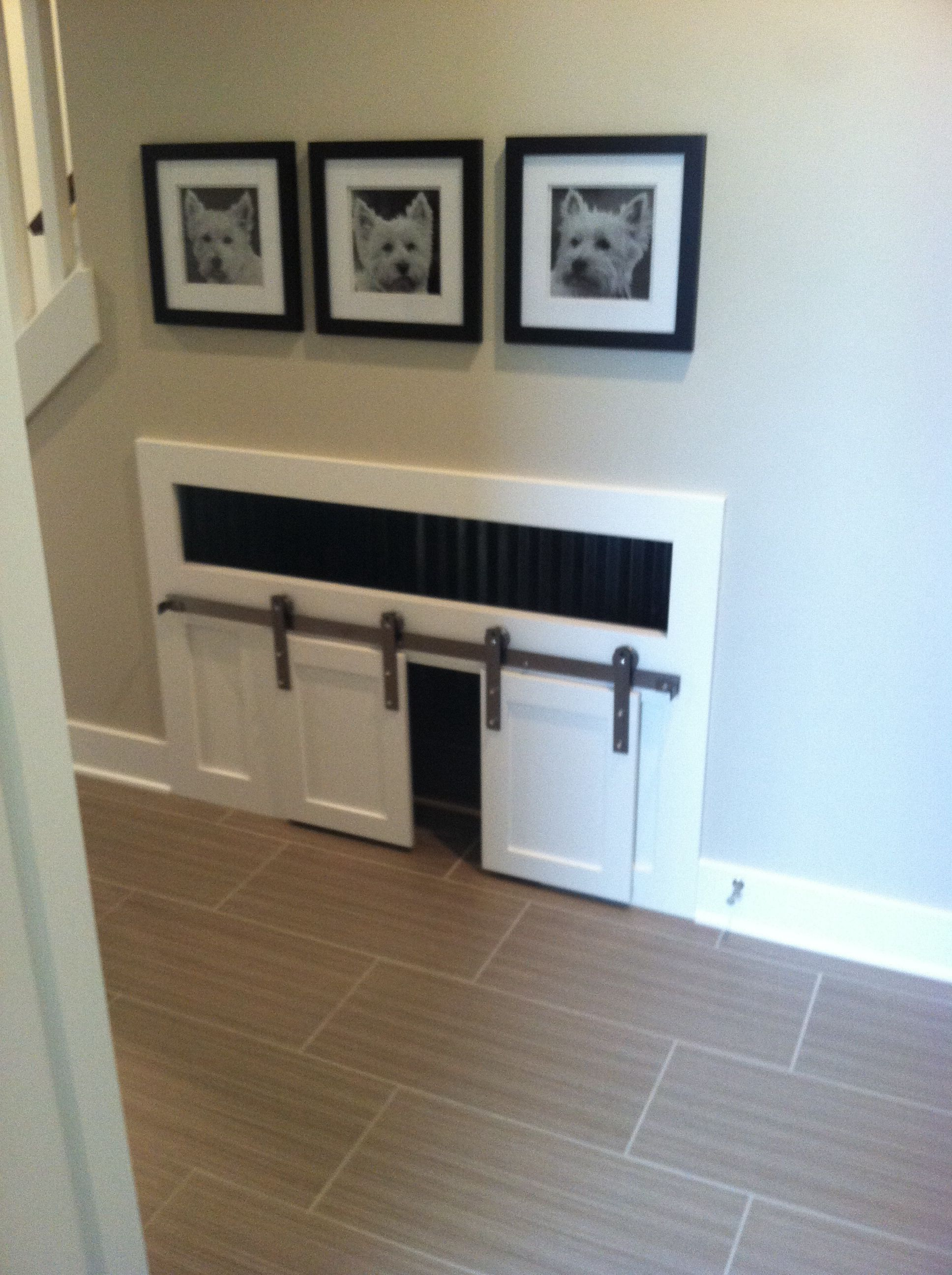 Dog kennel by front door into garage For the Home