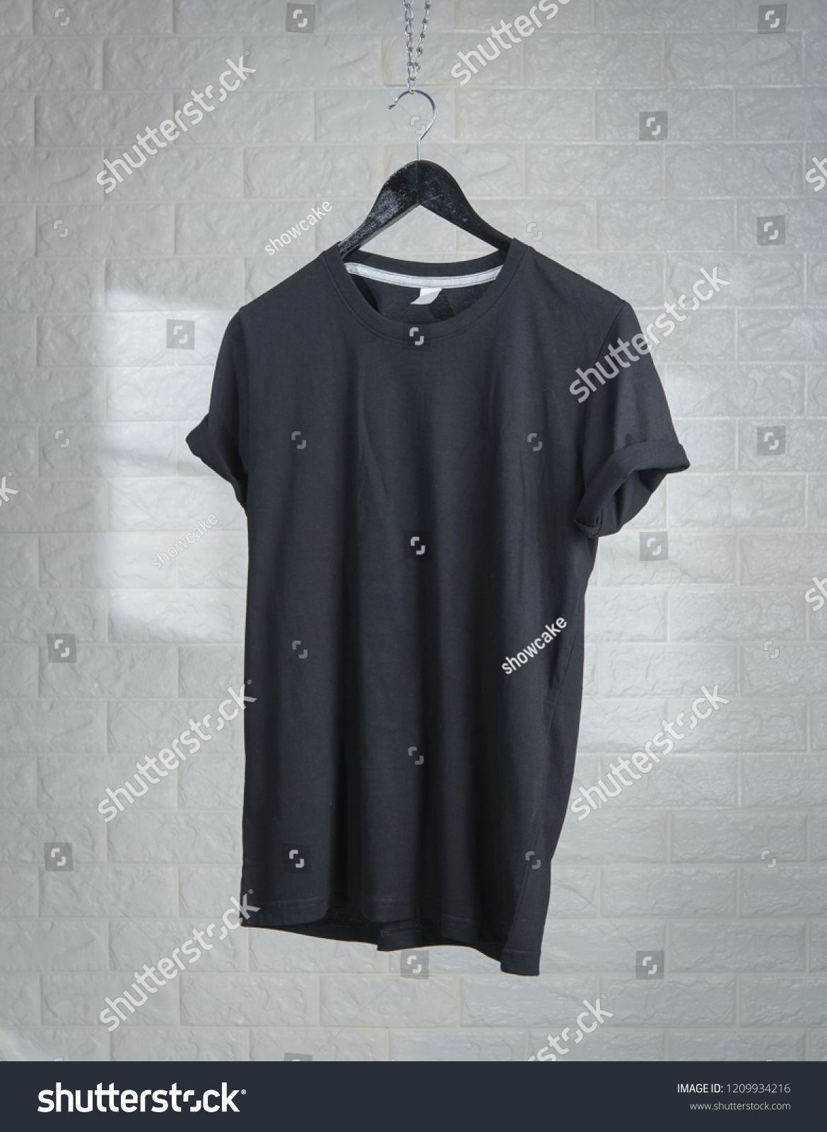Download Blank Black T Shirts Mock Up Hanging Against White Brick Wall Shadows From A Window Frame Mock Hanging Shirts Blank Black Tshirt Black Fashion