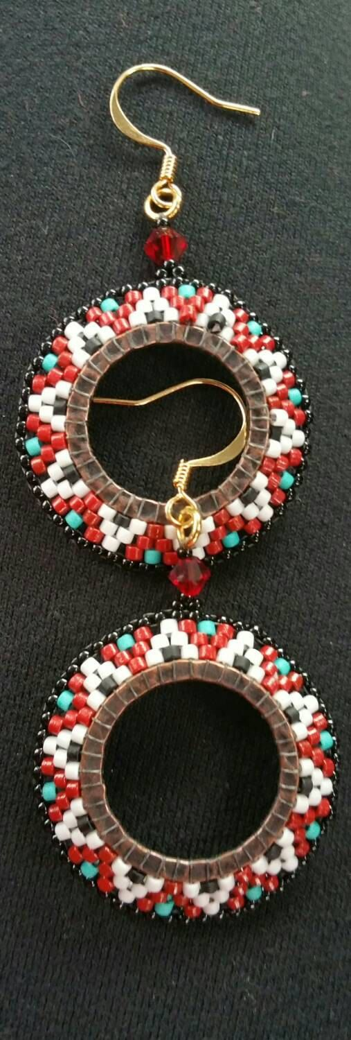 Check out this item in my Etsy shop https://www.etsy.com/listing/261940933/native-american-earrings-medallion