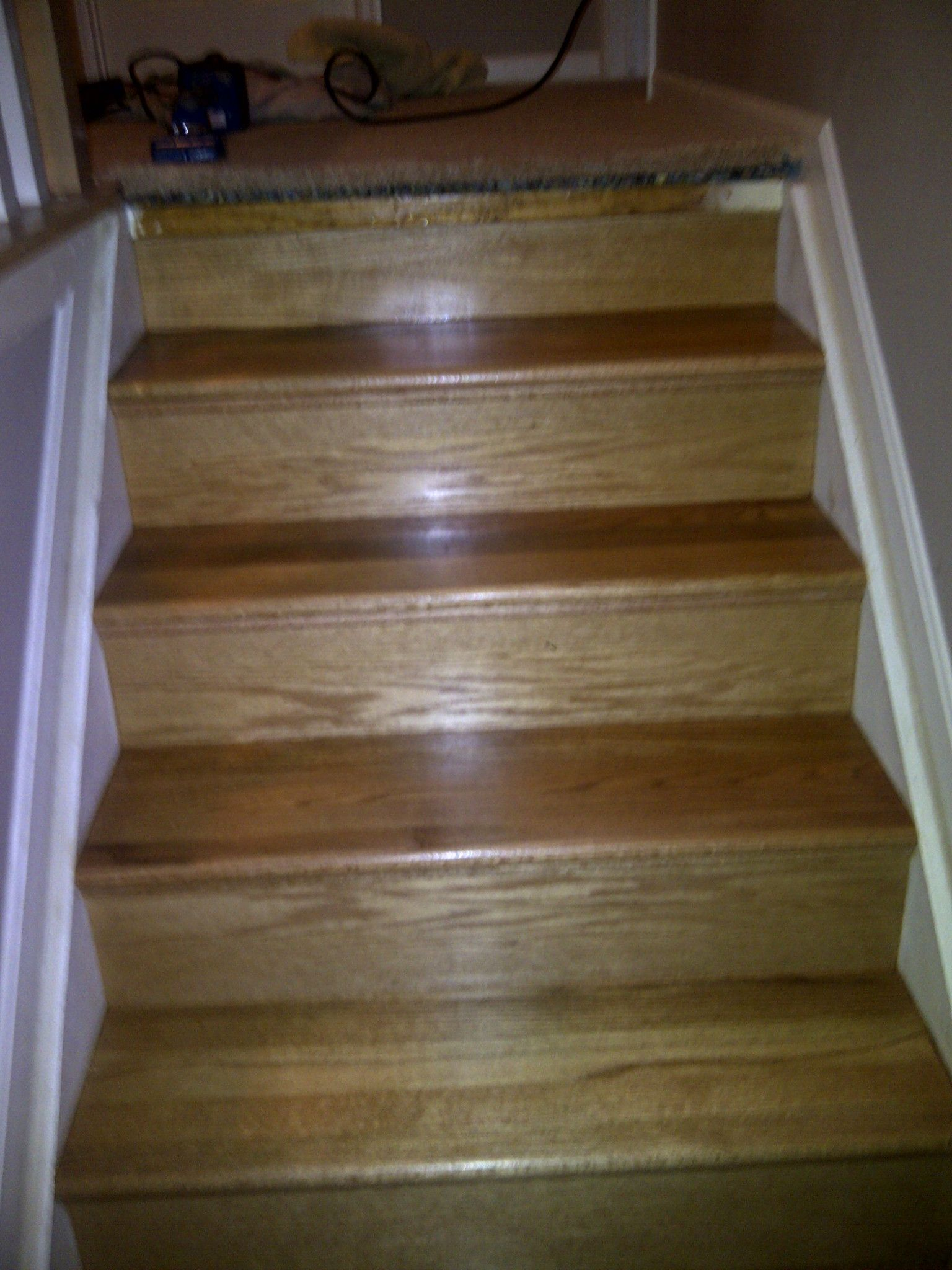 Custom new treads and risers that were installed stained and