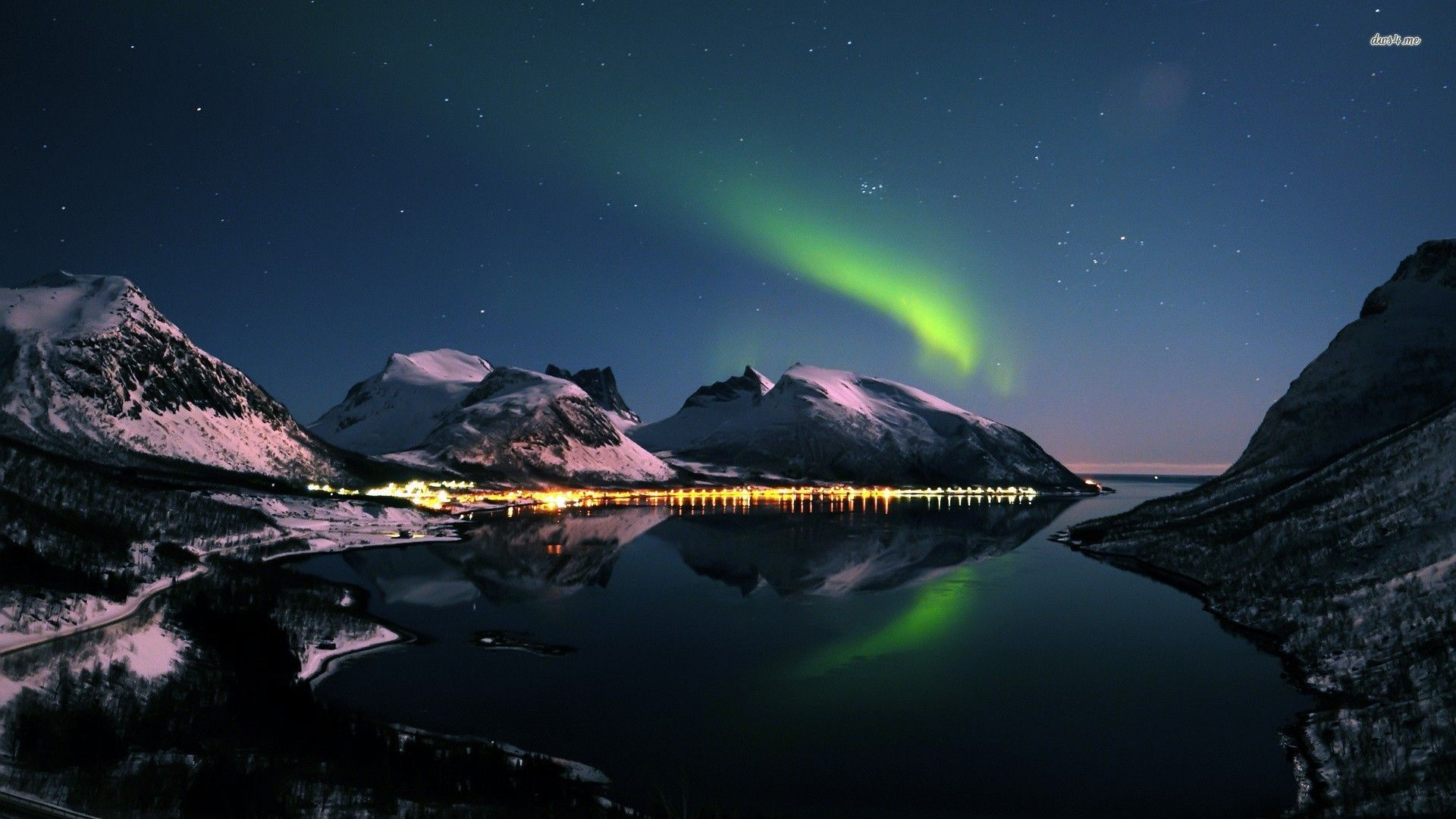 Northern Lights Over A Small Town In Norway