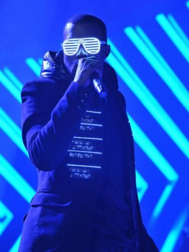 Kanye West Sends Out Neon Colored Vibrations During His Performance On The 50th Annual Grammy Awards On Feb 10 200 Workout Playlist Songs Photo Entertainment