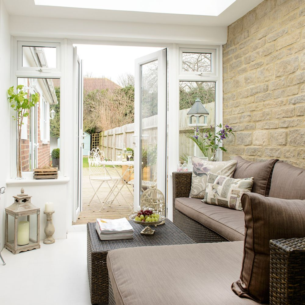 Compact conservatory with corner sofa