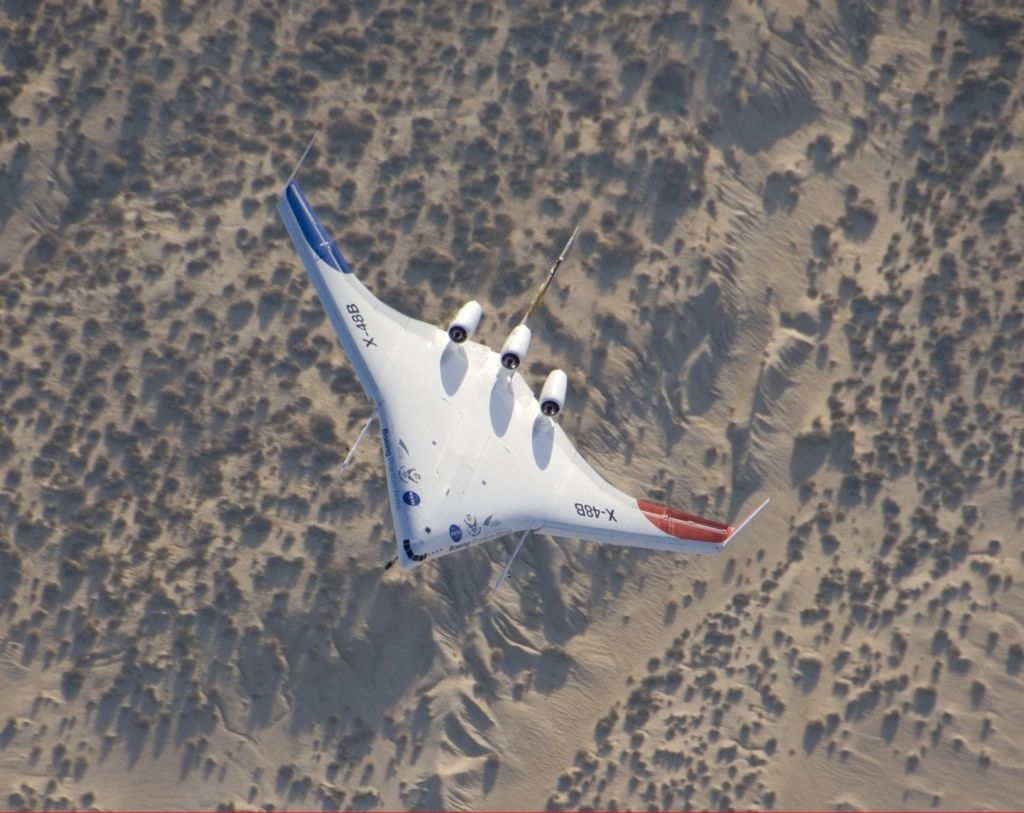 August 14, 2007 - The unique X-48B Blended Wing Body subscale demonstrator banks over desert scrub at Edwards AFB during the aircraft's fifth test flight.