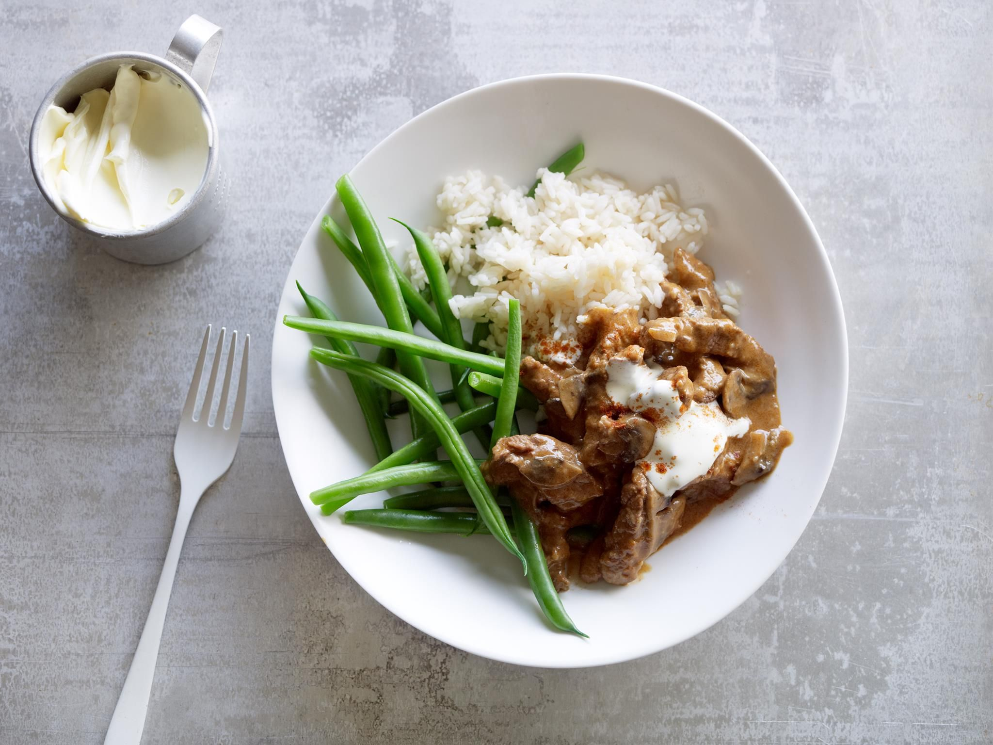 Beef stroganoff is great comfort food! Tender strips of beef and mushrooms are sautéed in butter, then swirled with sour cream to make a creamy sauce. Serve with rice, mashed potato or pasta