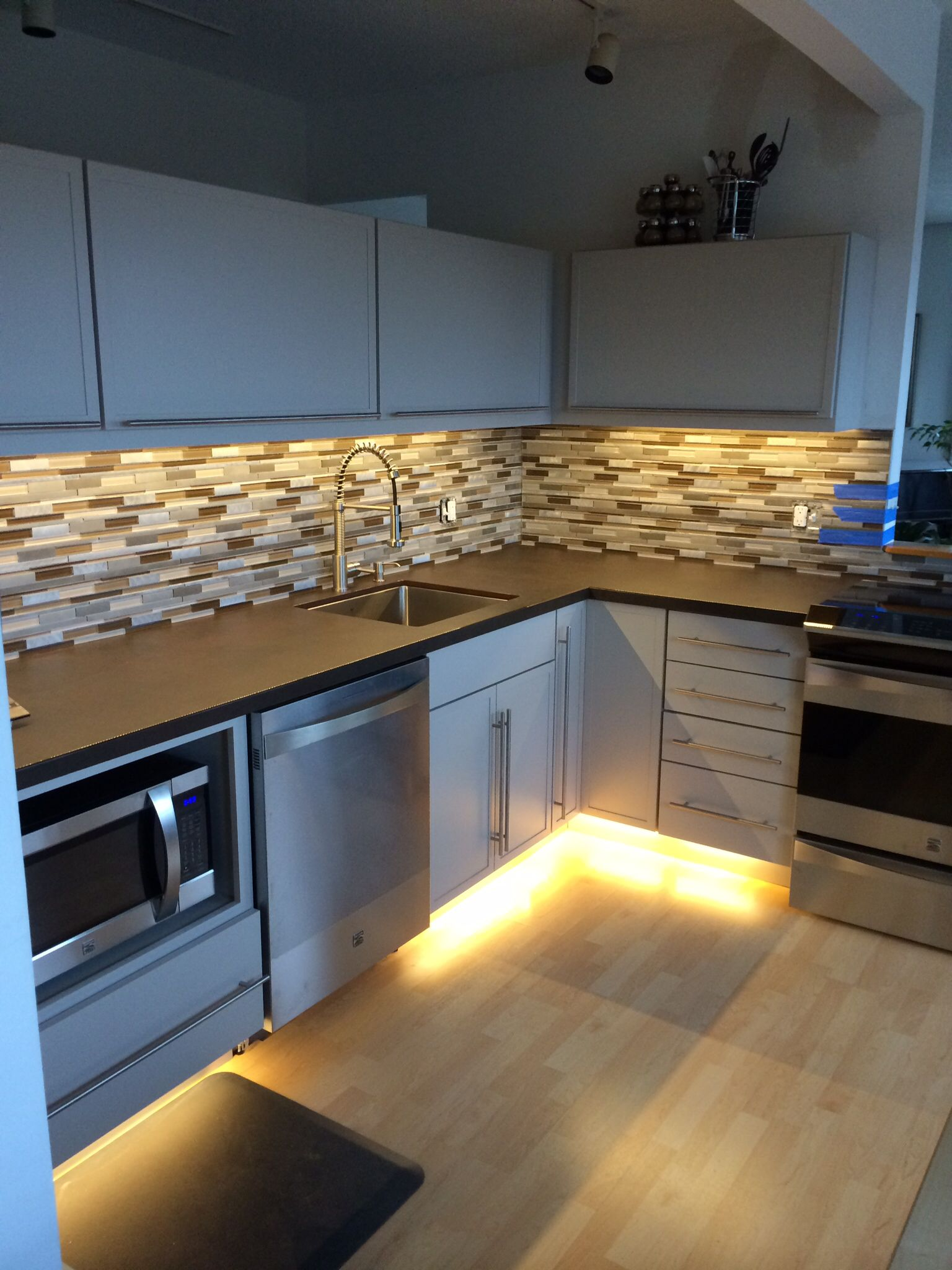 Martha Stewart cabinets with under cabinet lighting and Dekton