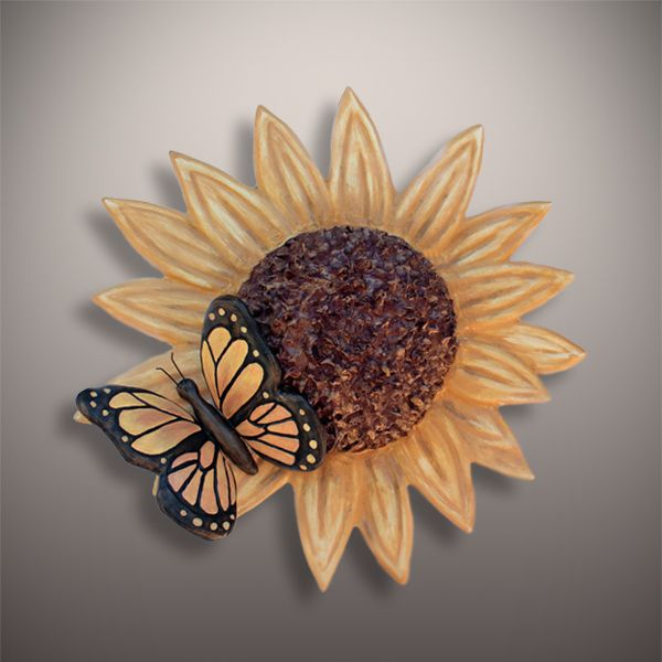 Handmade Ceramic Sunflower and Butterfly Cremation Urn - Urns Northwest. Cast, sculpted, fired, and finished by hand by a talented team of ceramic artists.