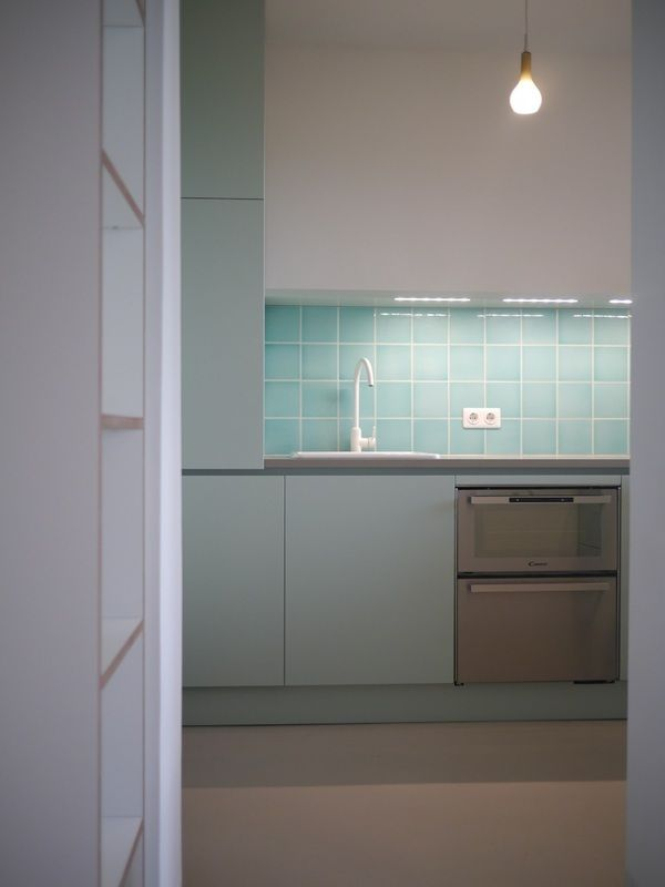 Introducing: our designers Rhea & Janna from Berlin. Design for a small apartment. Modern and minimal kitchen design in turquoise and white.  Click to find more inspiration!