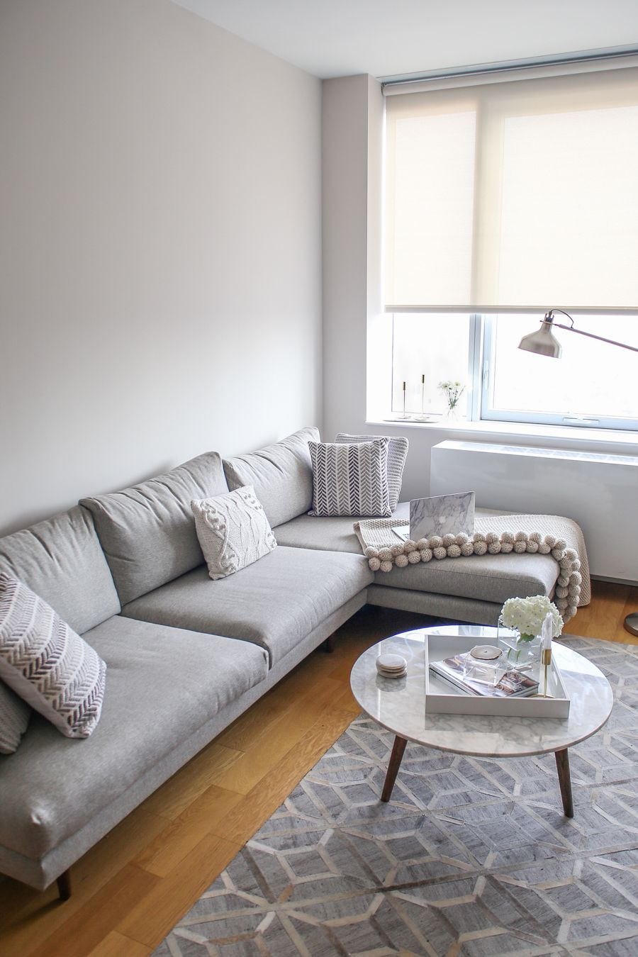 Nyc Living Room Apartment Grey Sectional Sofa With Wooden Floors Apartment Decor Living Room Living Room Decor Apartment