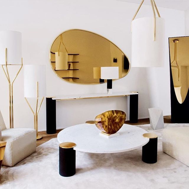 The Glowing Golds And Organic Shapes Makes This Living Room Design One Of A Kind Also In Love With The Contemporary Art Gallery Interior Contemporary Design