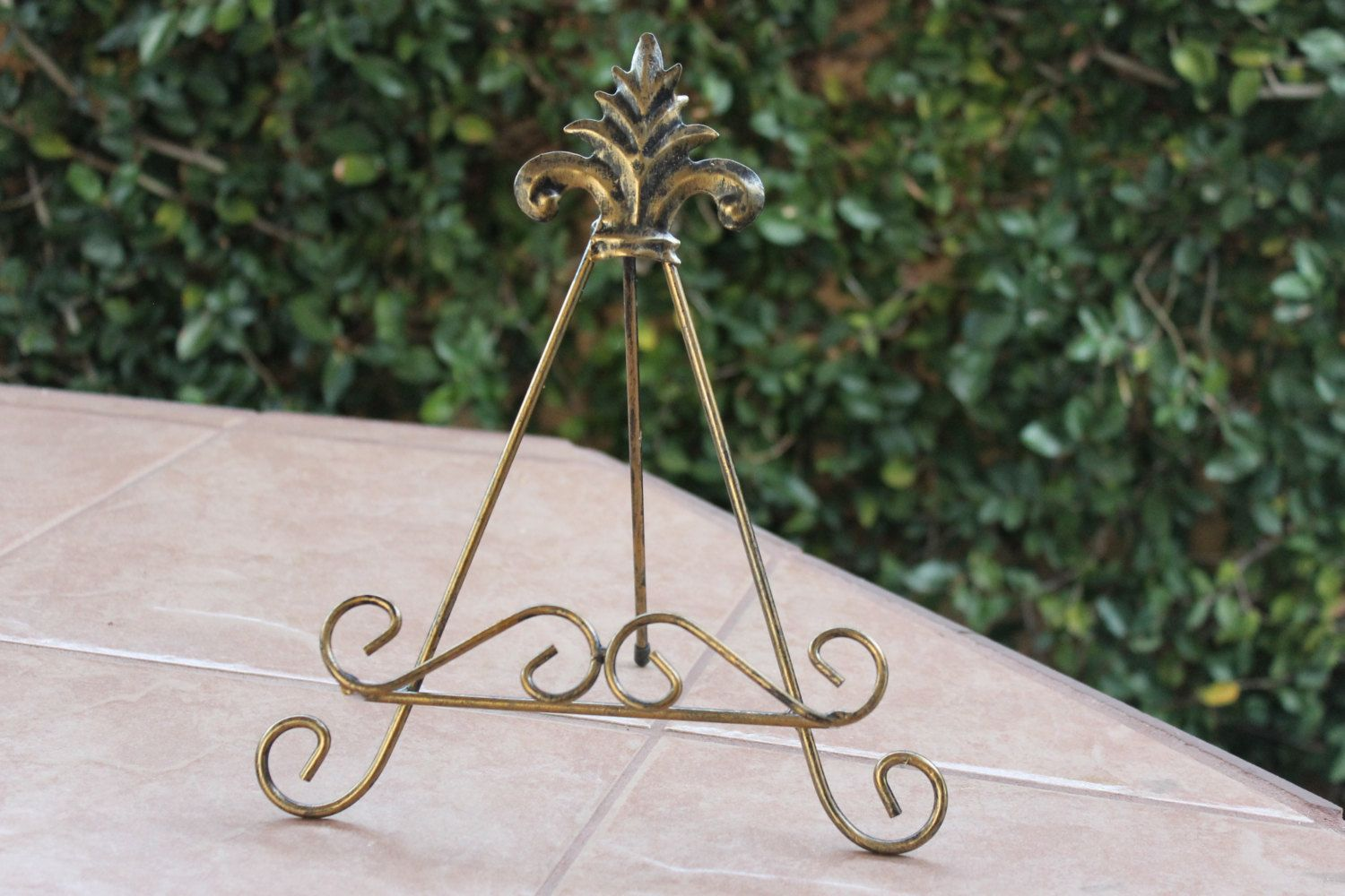 Decorative Rustic Iron Cutting Board Stand Hand Made Hammered and Welded Metal Black or Gold by LetsEngrave on Etsy https://www.etsy.com/listing/208197372/decorative-rustic-iron-cutting-board