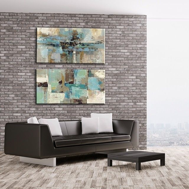 We took 2 of our abstract prints and made them into canvases for this modern living room. We have thousands of prints online and can even make them canvases as well. Email us with any requests at homedecor4seasons@yahoo.com