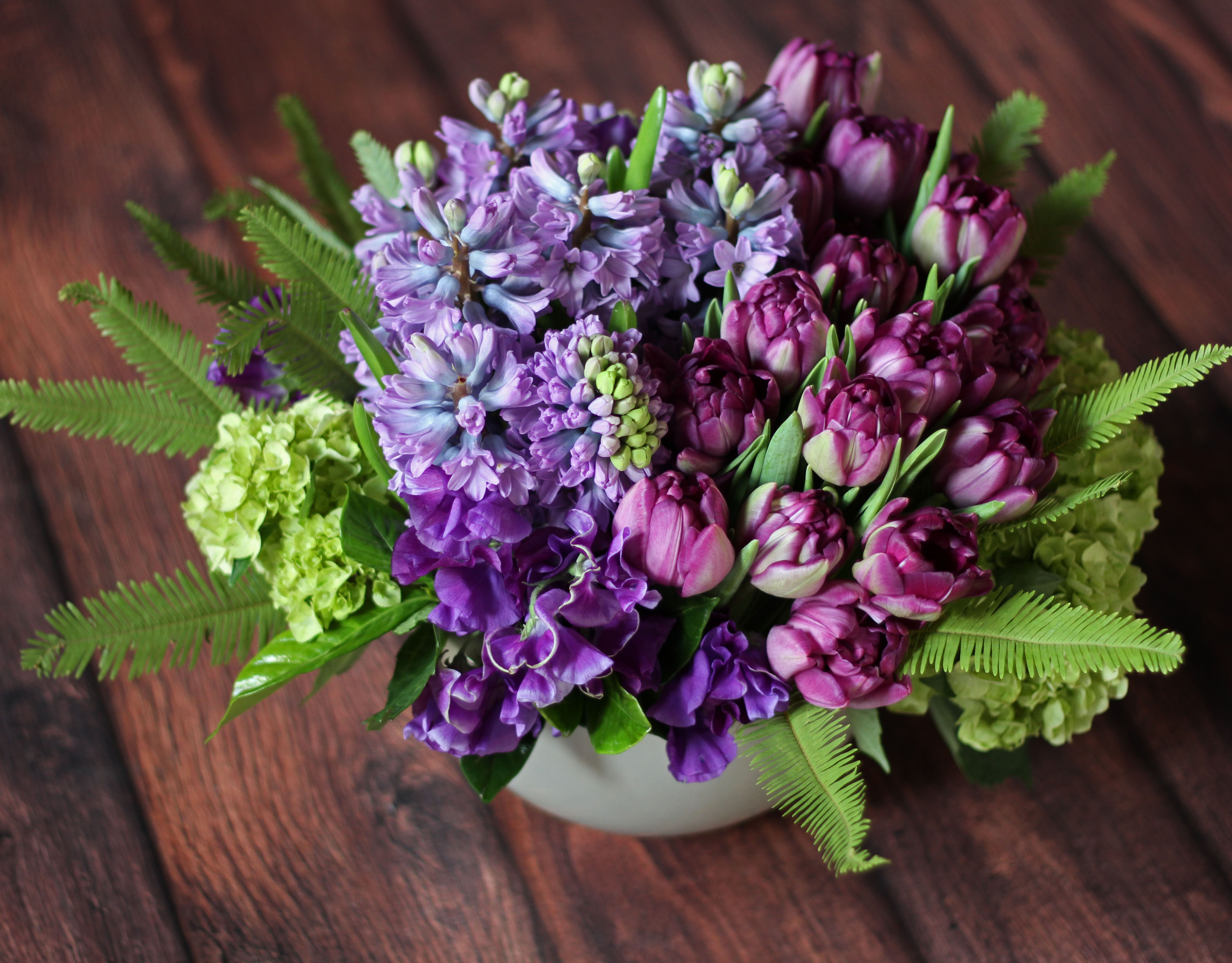 Shades of deepening violet unfold in an ombré fashion: 'Violet Abundance' by Winston Flowers.