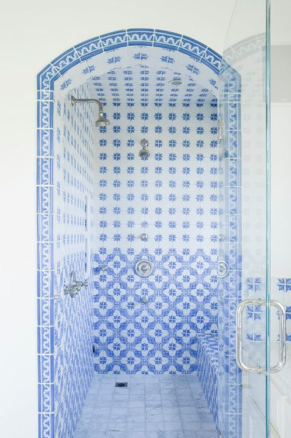 spode blue italian bathroom with arch blue and white tile glass shower door tile