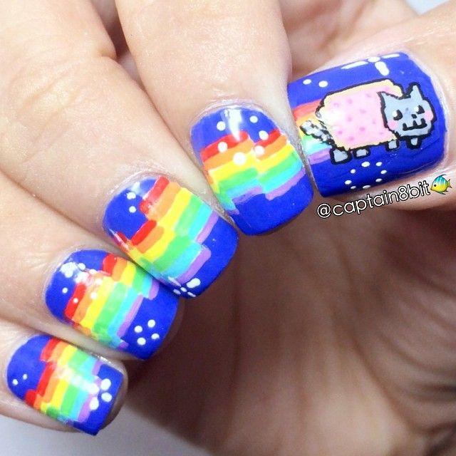 decorando uñas con gato cosmico