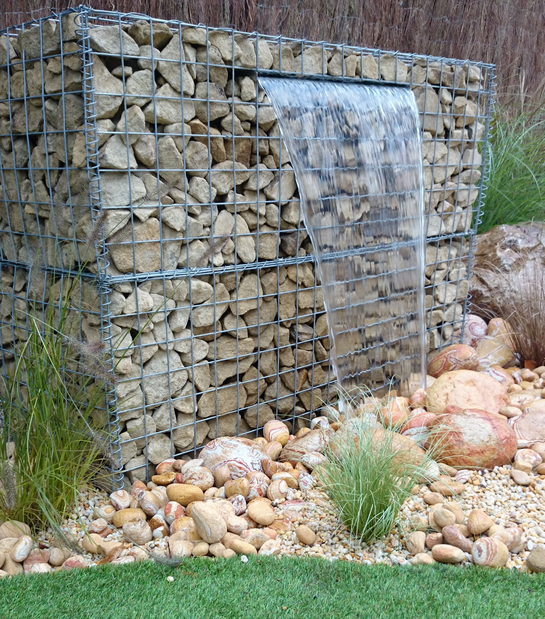 Garden Feature Wall: Gabion Water Feature Tumbling Over Rainbow Cobbles In 2019