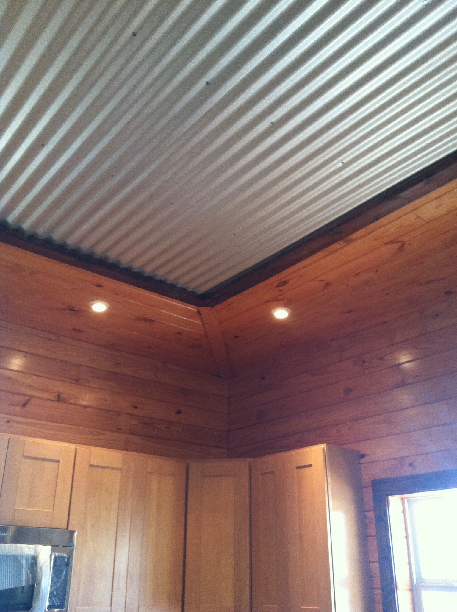 Interesting tin ceiling framed by tounge and groove pine for Metal shiplap siding