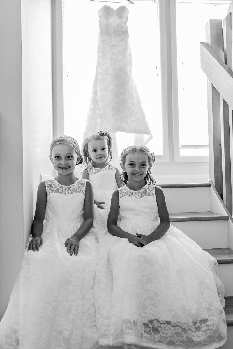 Flower girls poses for camera, Pepper Plantation, Awendaw, South Carolina. Kate Timbers Photography. http://katetimbers.com #katetimbersphotography // Charleston Wedding Photography // Photo Inspiration