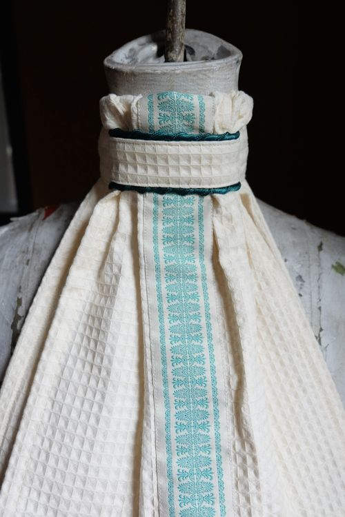 Ivory waffle stock tie with dark green rope cording and the most lovely vintage embroidered trim down the center in a lovely minty turquoise. equus-couture.com or facebook.com/equuscouture