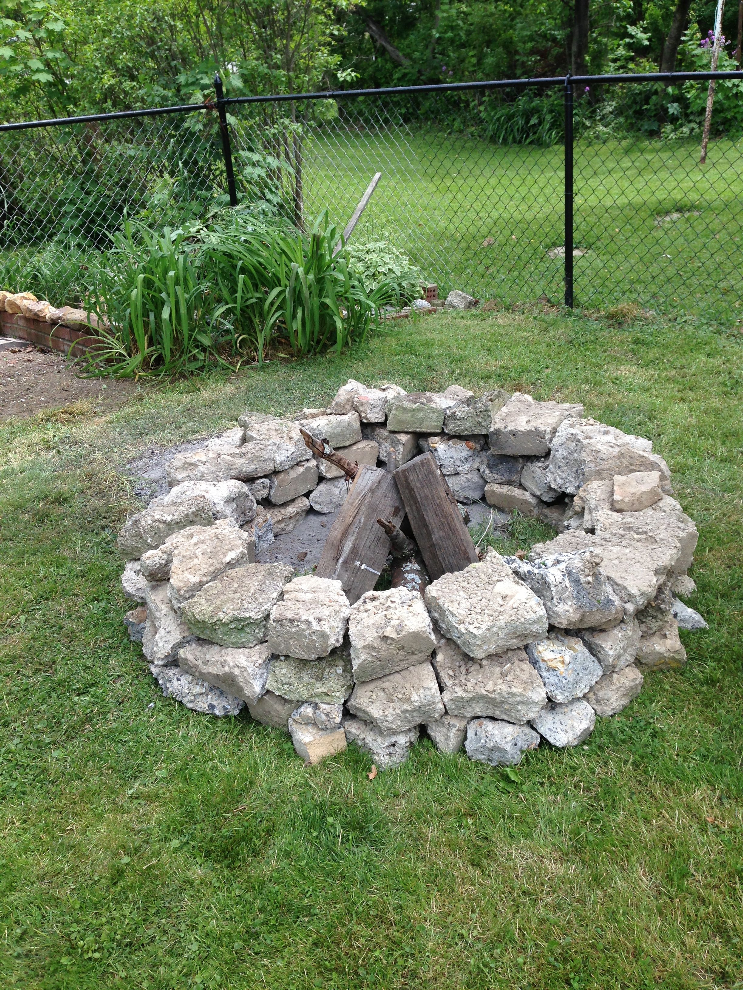 old cement sidewalk pieces recycled into a fire pit cool stuff