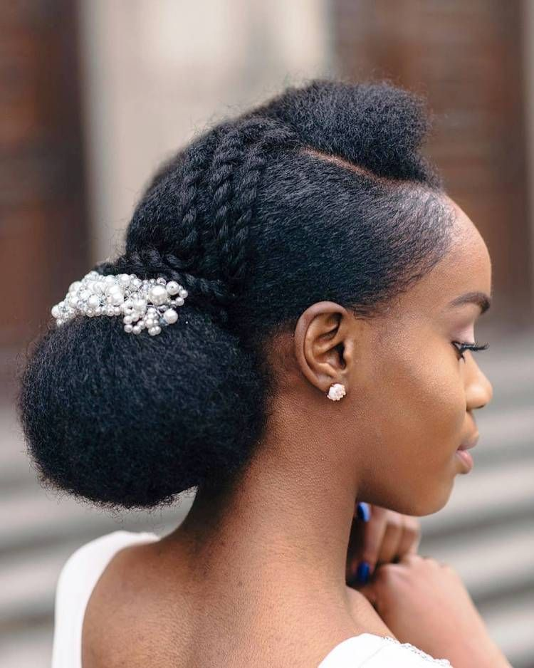 Romantic Bridal Updos Gorgeous Black Bride With An Elegant Low Bun Embellished By Small Natural Hair Wedding Natural Hair Bride Natural Wedding Hairstyles