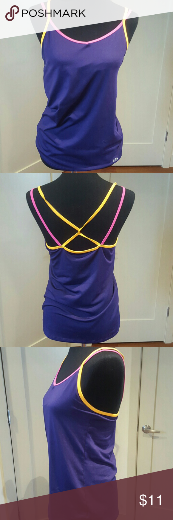 Workout tank/ sports bra Brand new multi colored champion brand tank with attached sports bra Poly/ spandex mix Champion Tops Tank Tops