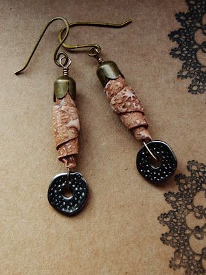 Rolled clay rustic beads and forged brass earwires by me. Discs  I shopped from SmallAndBeautifulBeads.