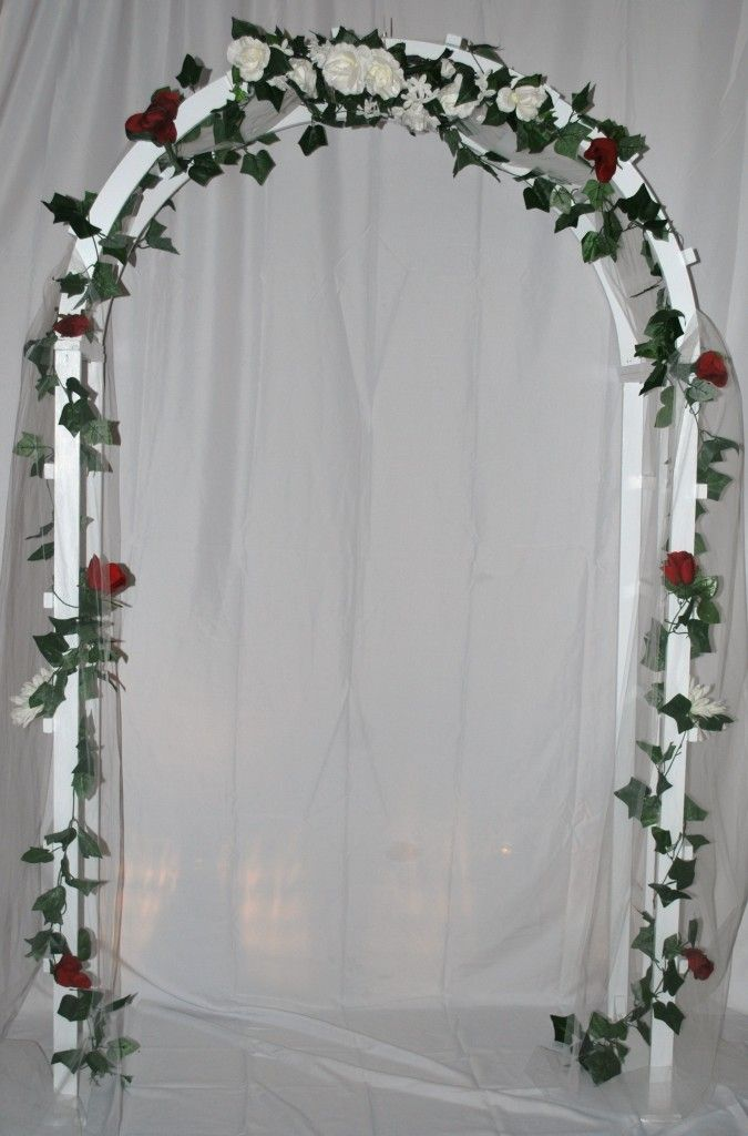 Nice wedding arch decoration with white cloth wrapped lattice with nice wedding arch decoration with white cloth wrapped lattice with small flowers seasonal beautiful pictures junglespirit Choice Image