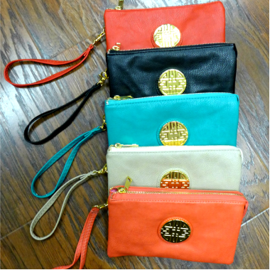 Clutch Medallion - Great to add a POP of color to your outfit!