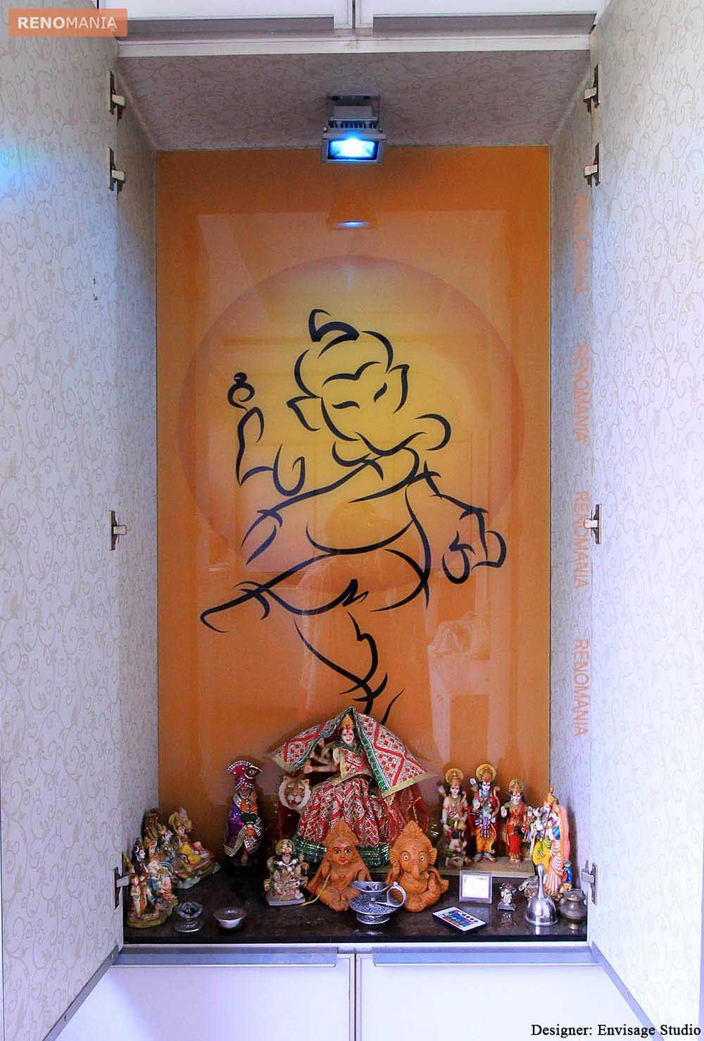a small puja space with idols and wall painting of Ganesha | Pooja ...