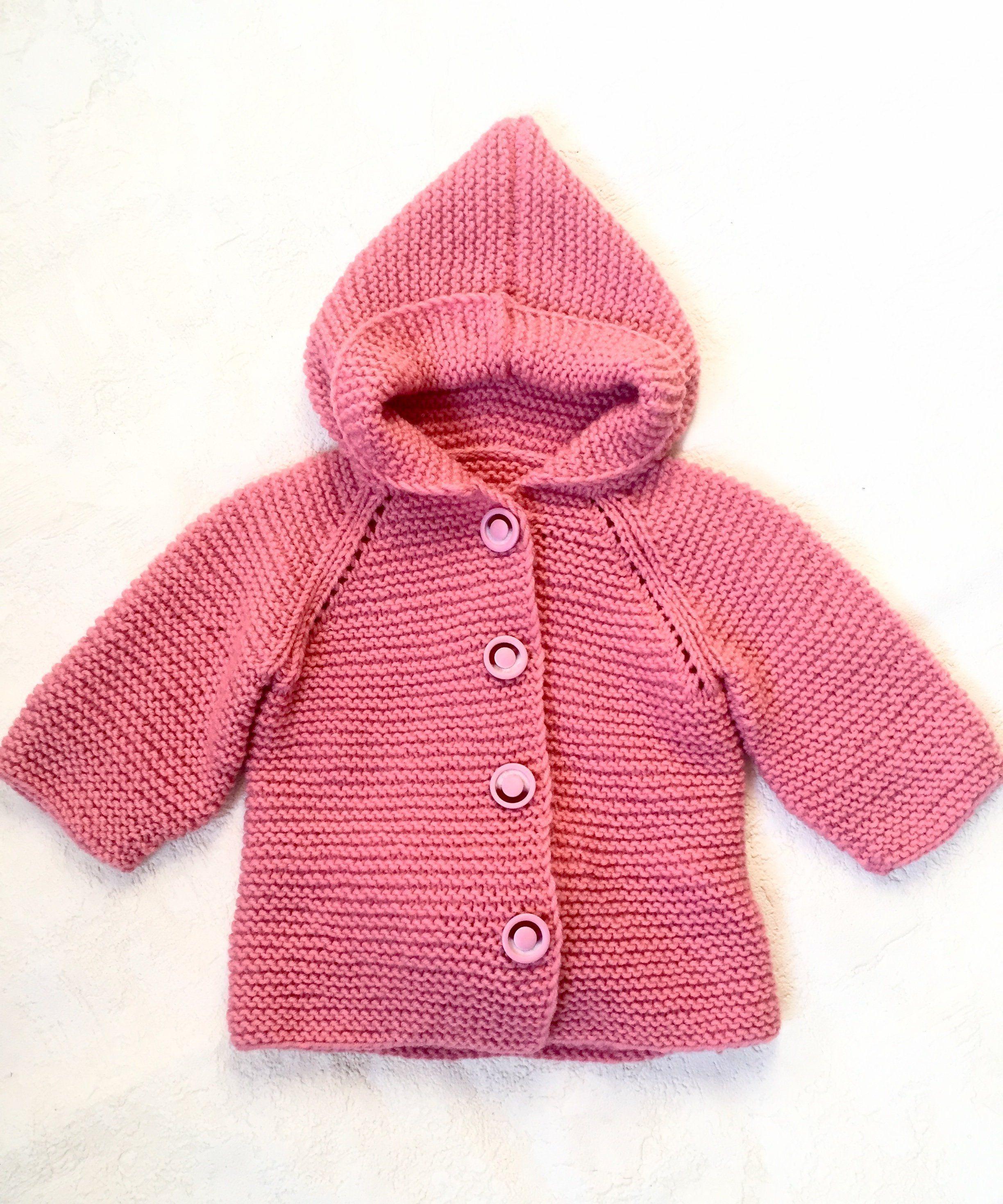 Малышка в розовой кофте.