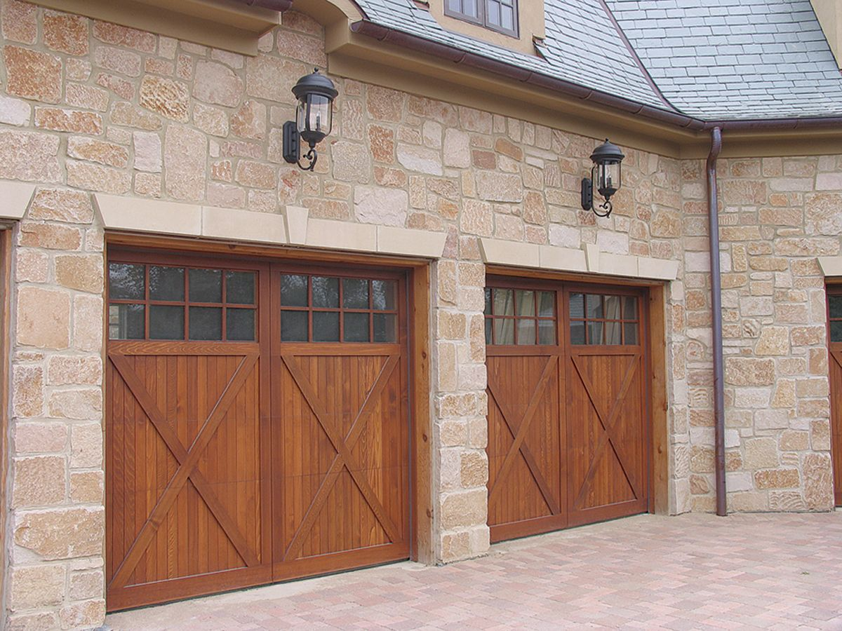 Wood carriage style garage doors raynor wood for Carriage type garage doors